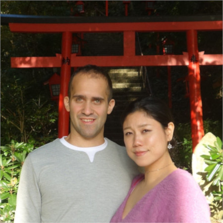 Riho and Gabriel next to torii in Japan
